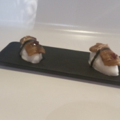 """Nigiri"" made from eggplant and some kind of merengue on the bottom."